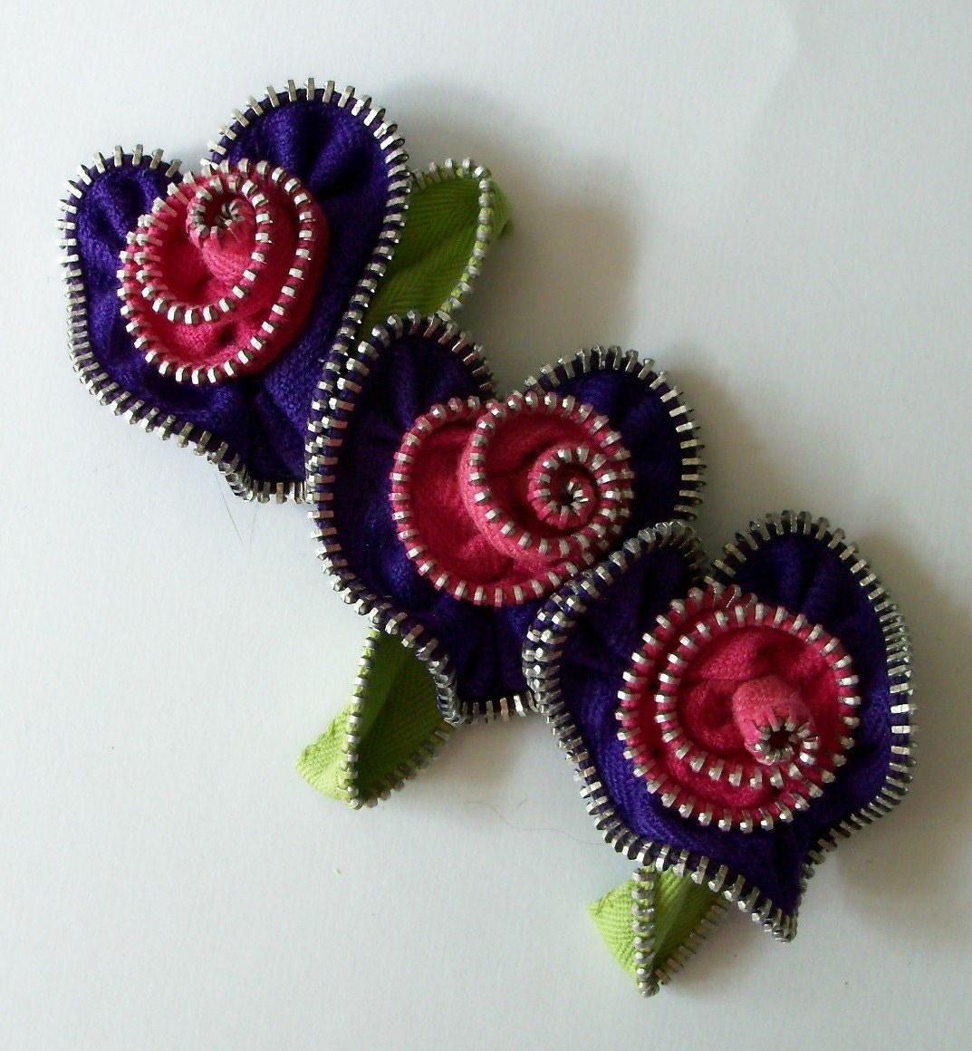 Purple and red roses in a row zip brooch, via Etsy: ZipPinning