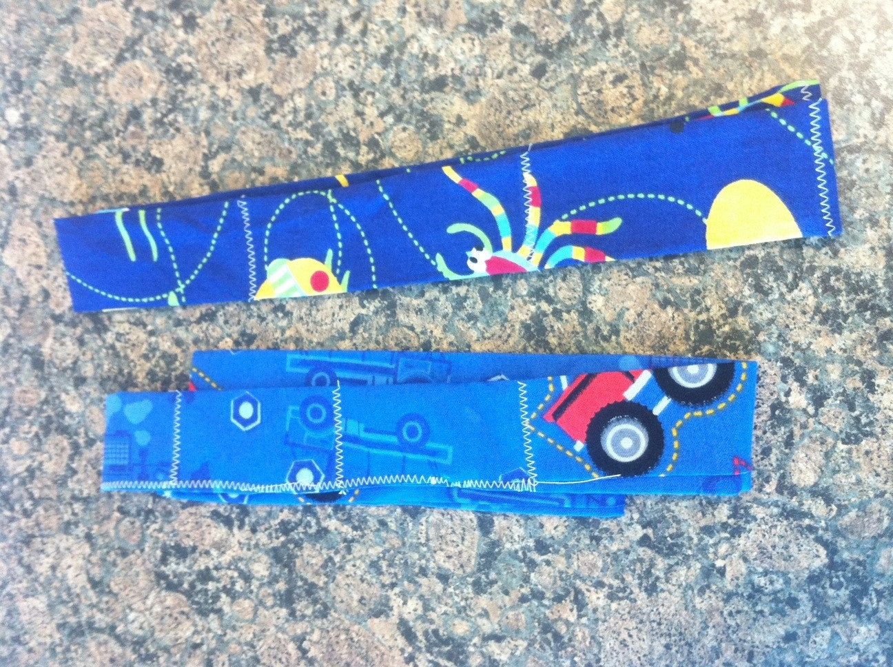2 boys col neck bands colling scarves bugs and trucks