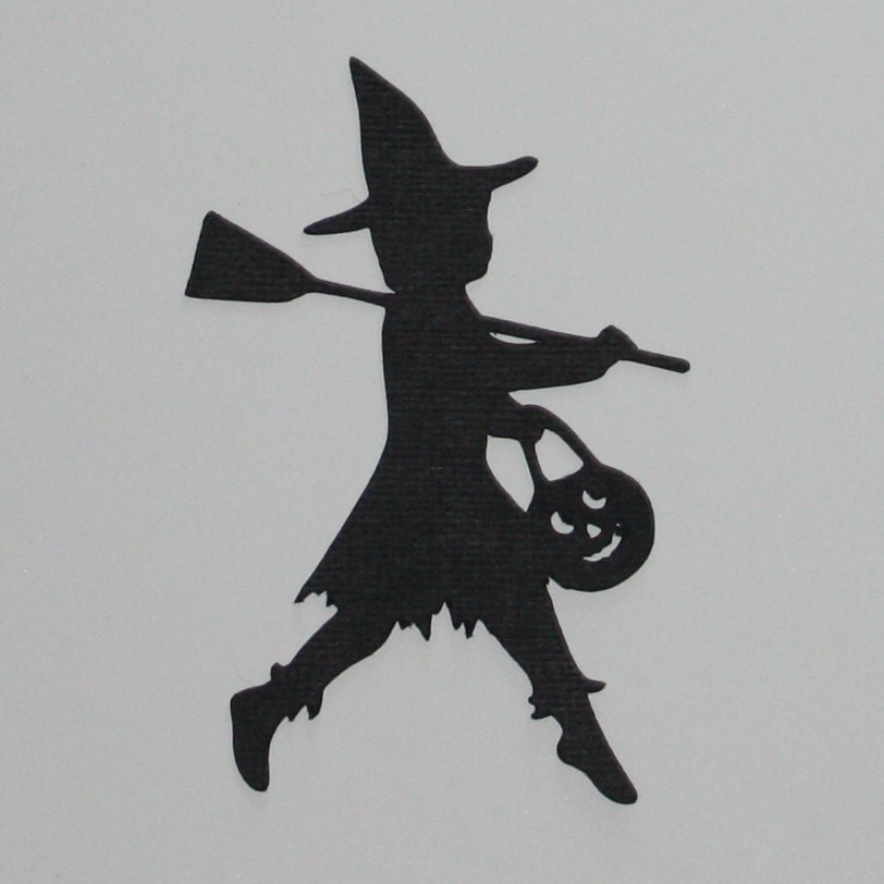 black silhouette halloween die cut child trick or treating in a witch costume