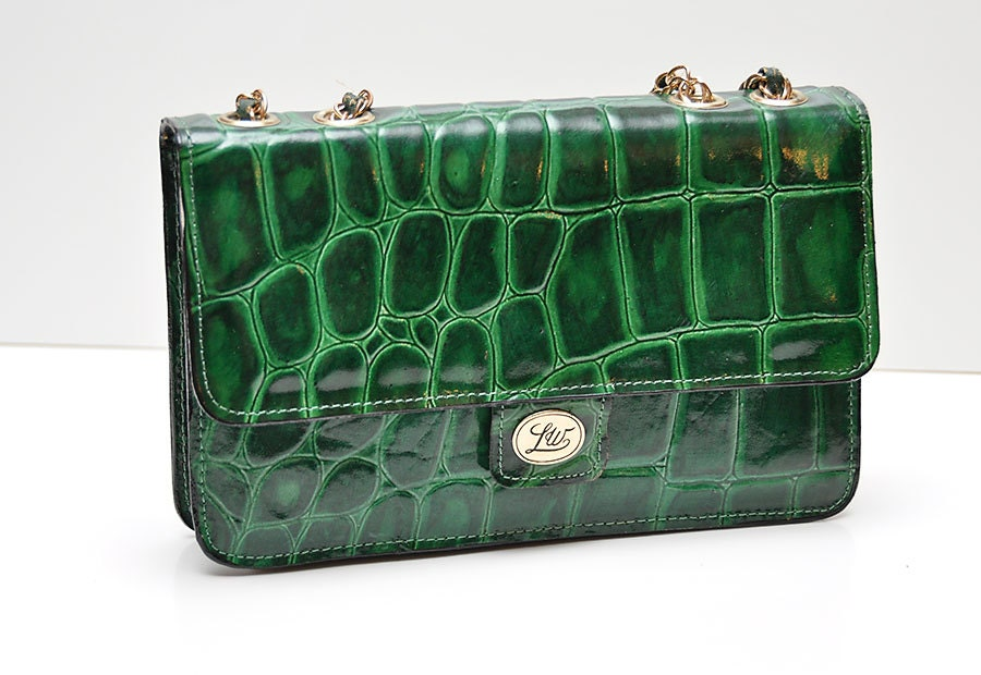 green alligator purse with emerald leather and gold accent chain