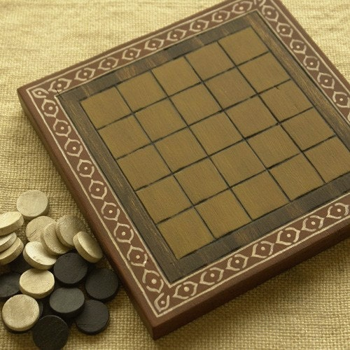 ANCIENT BOARD GAME: Helga (Libyan Desert, Sahara, Africa).