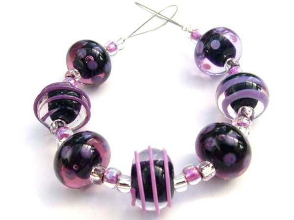 A beautiful set of handmade lampwork beads in shades of purple
