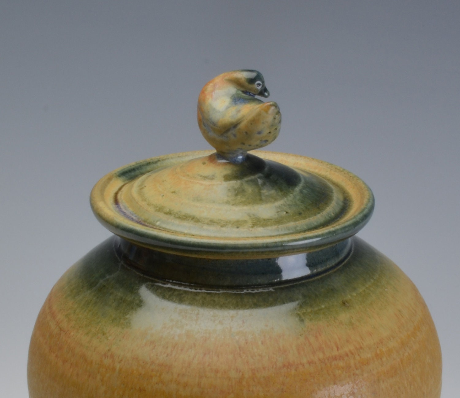 Memorial/Cremation Urn sculpted Bird with earthy ochre and blue green glazes