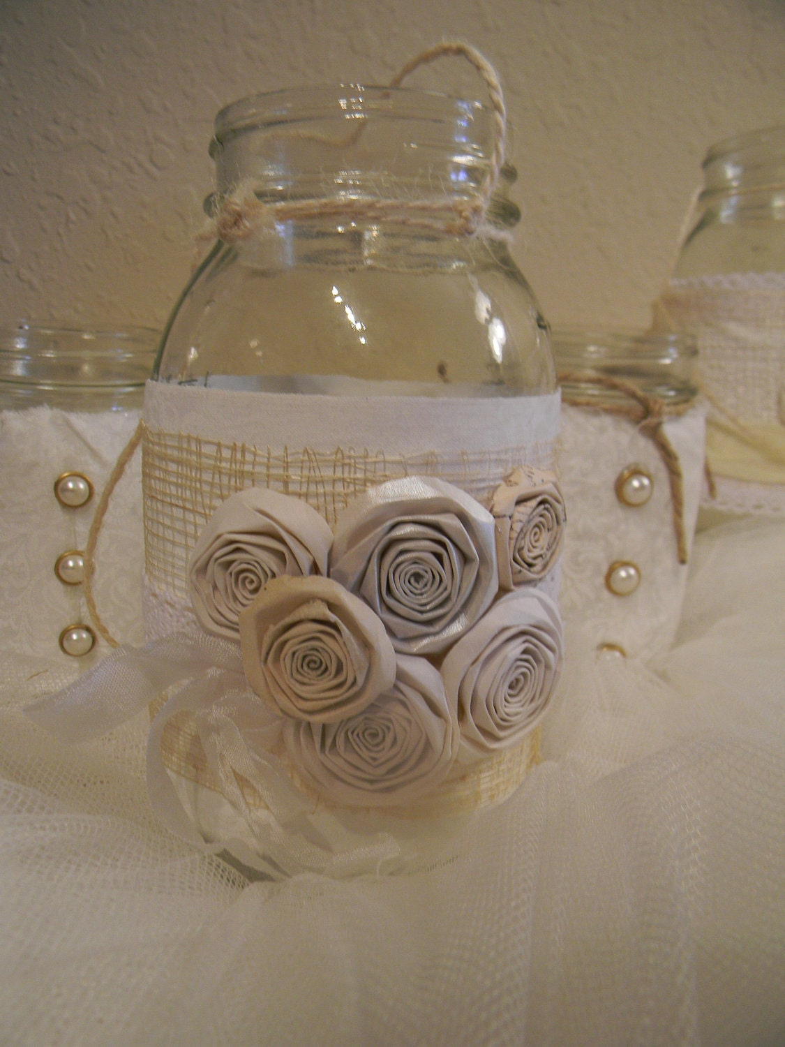 White upcycled mason jars/ wedding centerpieces