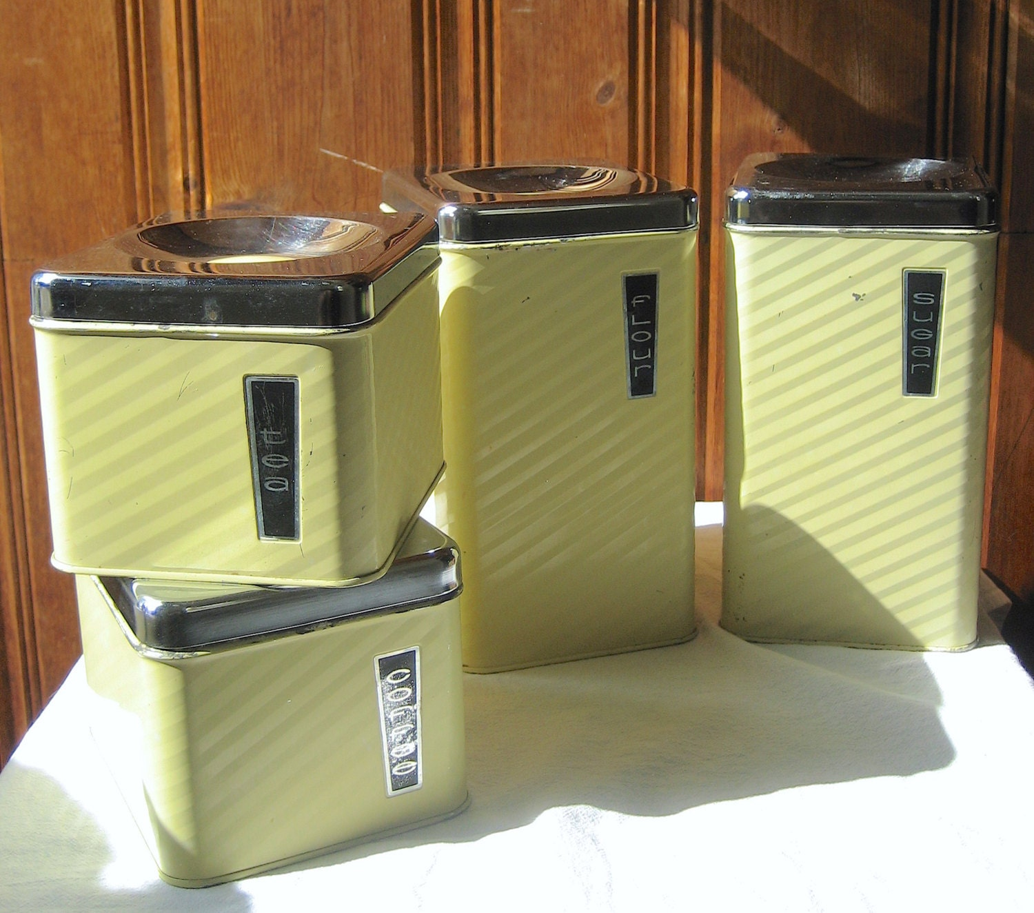 Mod set of four metal canisters vintage by verdellafabricraft