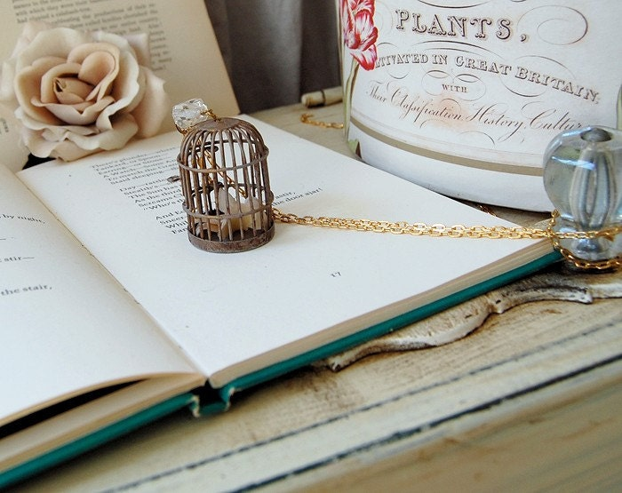 Very limited edition. Patina birdcage and little birdie.