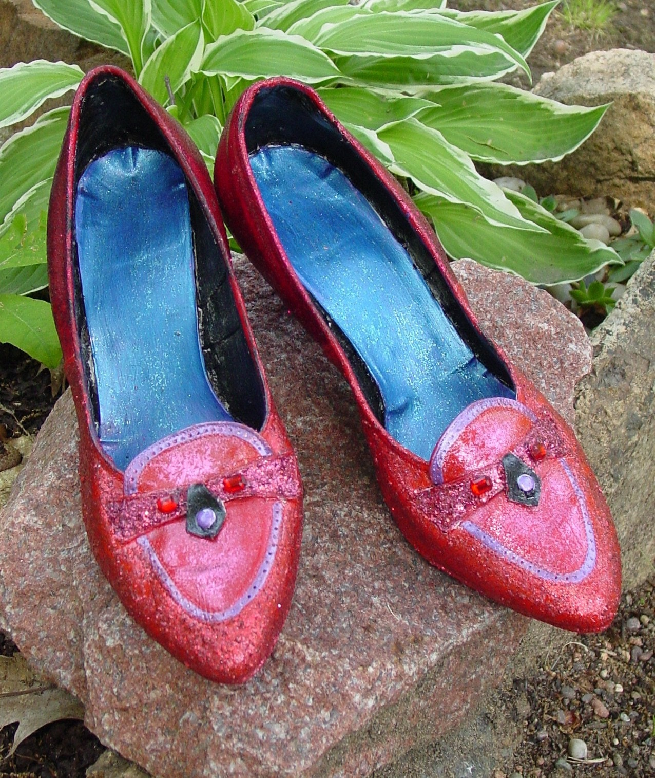 One of a series of four  recyled vintage hand made theatrical shoes for dorothy from the wizard of Oz by recyled artist Catherine Reine.Watch out they are  Magical they will take you home