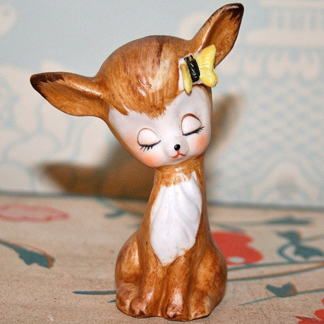 Adorable deer figurine with little yellow butterfly