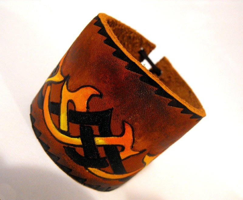 Leather tribal tattoo bracelet. From LeatherDesign