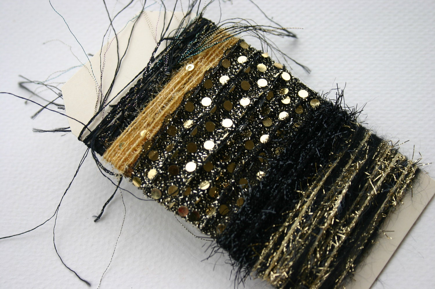 Elegant gold and black metallic specialty yarn fiber embellishent bundle