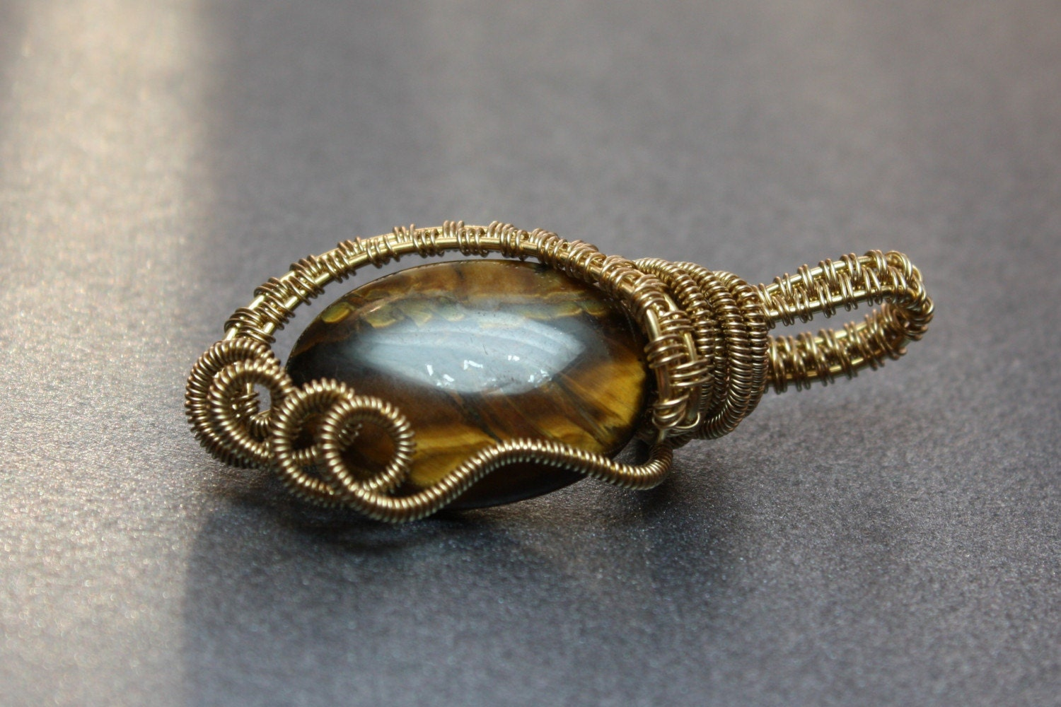 Handmade wire woven tiger eye pendant
