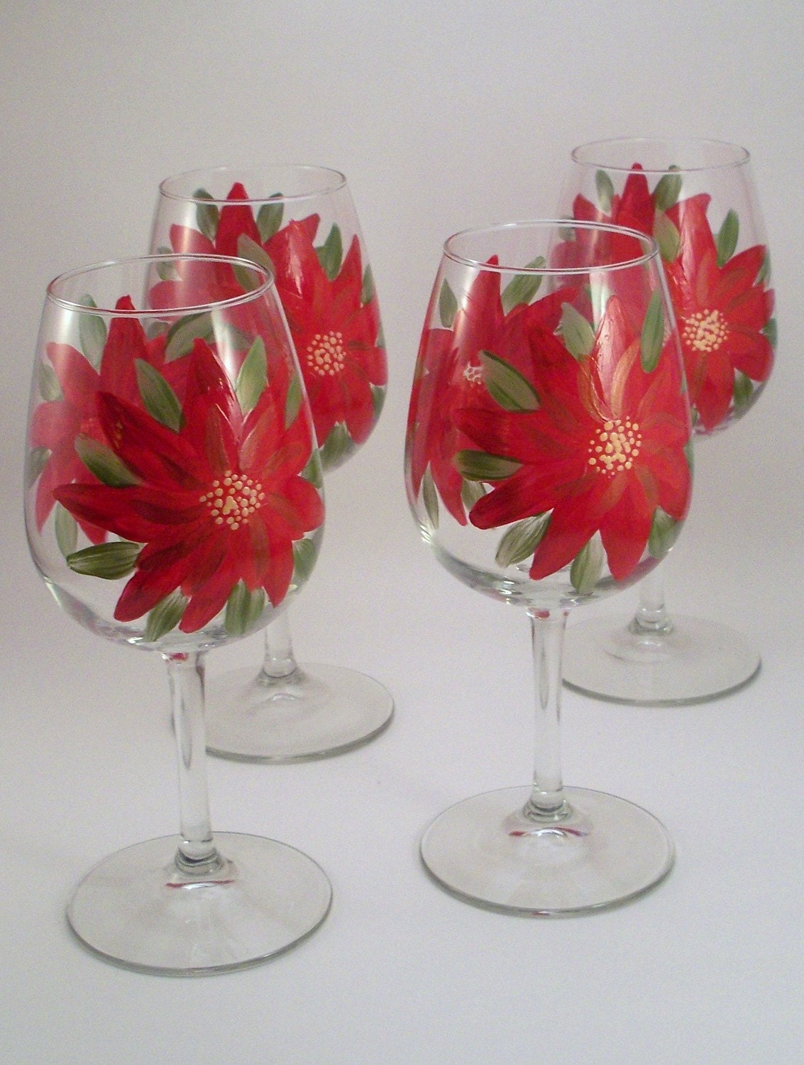 Items similar to red poinsettia flowers holiday stemware for Holiday stemware