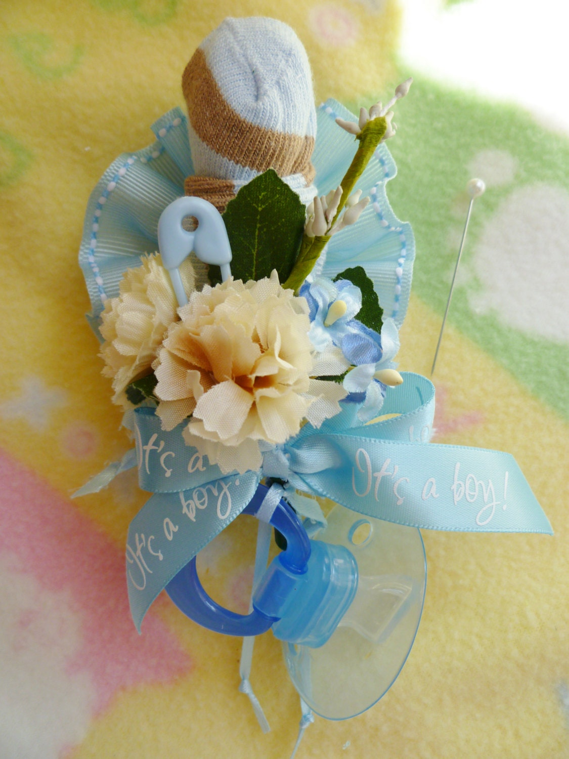 mom to be baby shower corsage with booties and pacifier for baby girl