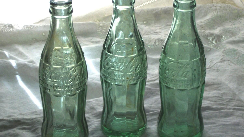 dating vintage coke bottles Vintage photos of alabama's soft-drink click here to see a slideshow of 11 of alabama's most unusual vintage a purple coke bottle made.