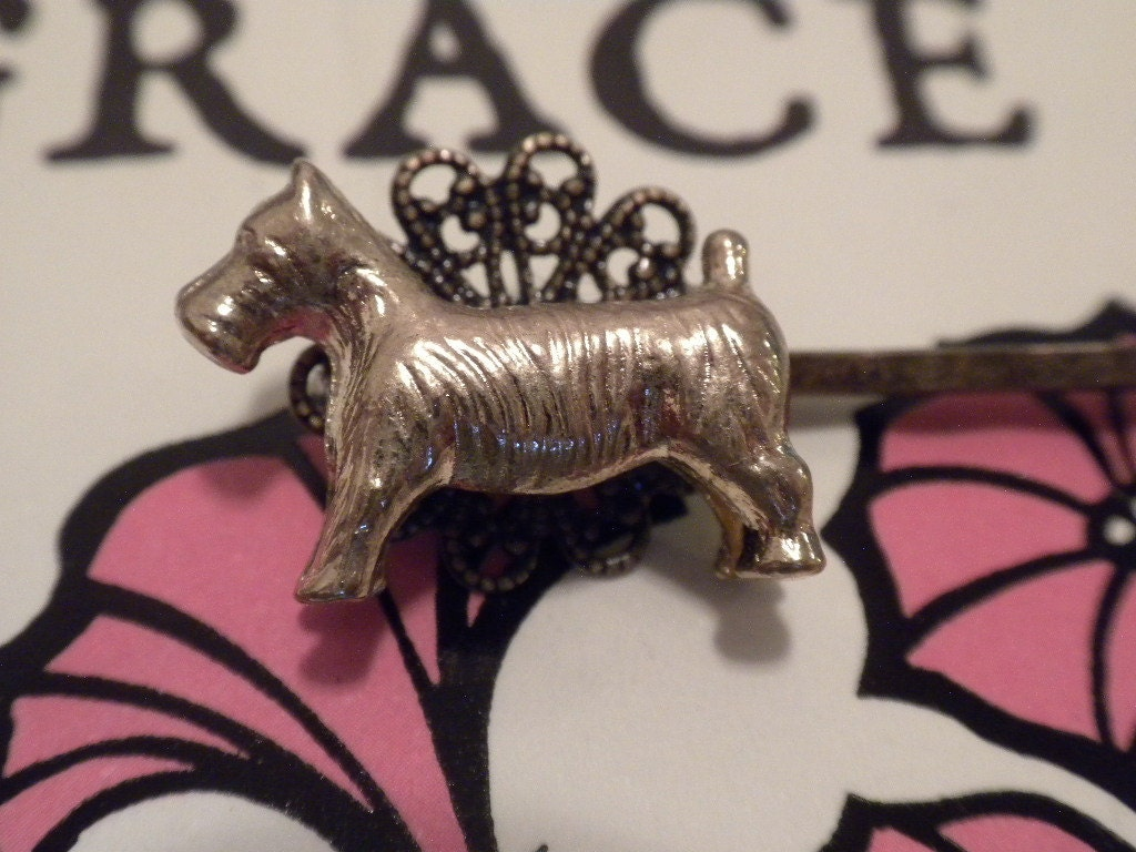 Bobby pin in the shape of a scottie-breed dog