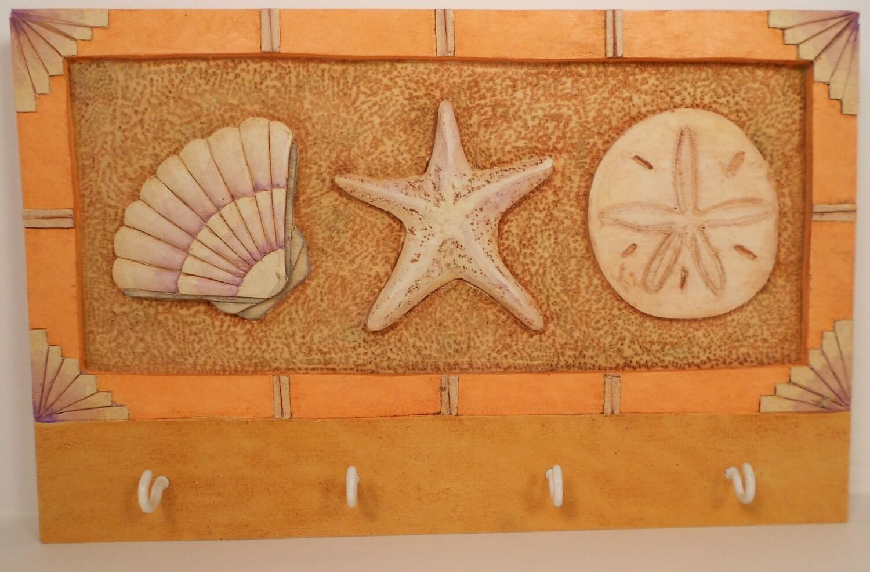 Items similar to key ring holder seashell wood carving