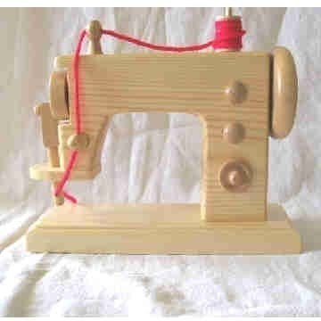 Toy wooden sewing machine just like moms