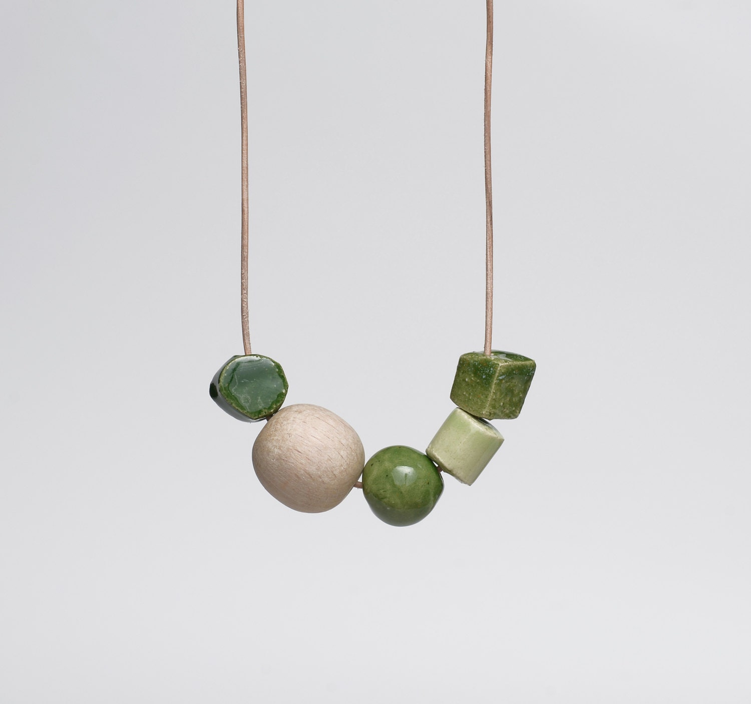 Emerald Green Ceramic Necklace With a Wooden Bead Modern Mixed Media Jewellery Moss Green - terrafique