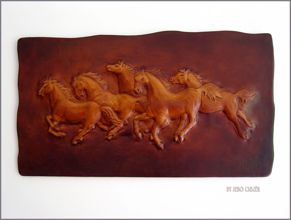 Five wild horses in leather