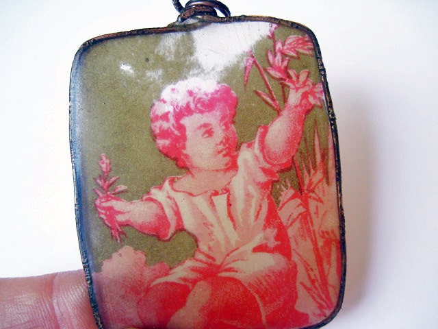 Cherub. Rustic Ephemera and Resin Translucent Pendant with Vintage Tobacco Advertisement.