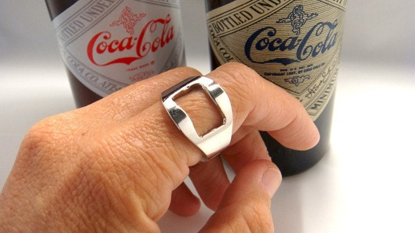 Open your beer  -  woman metal opener bottle ring