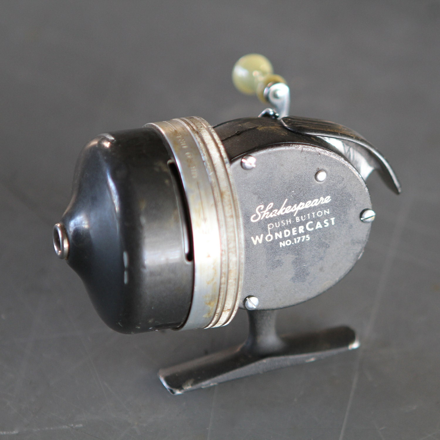 Vintage shakespeare wondercast fishing reel by for Push button fishing reel