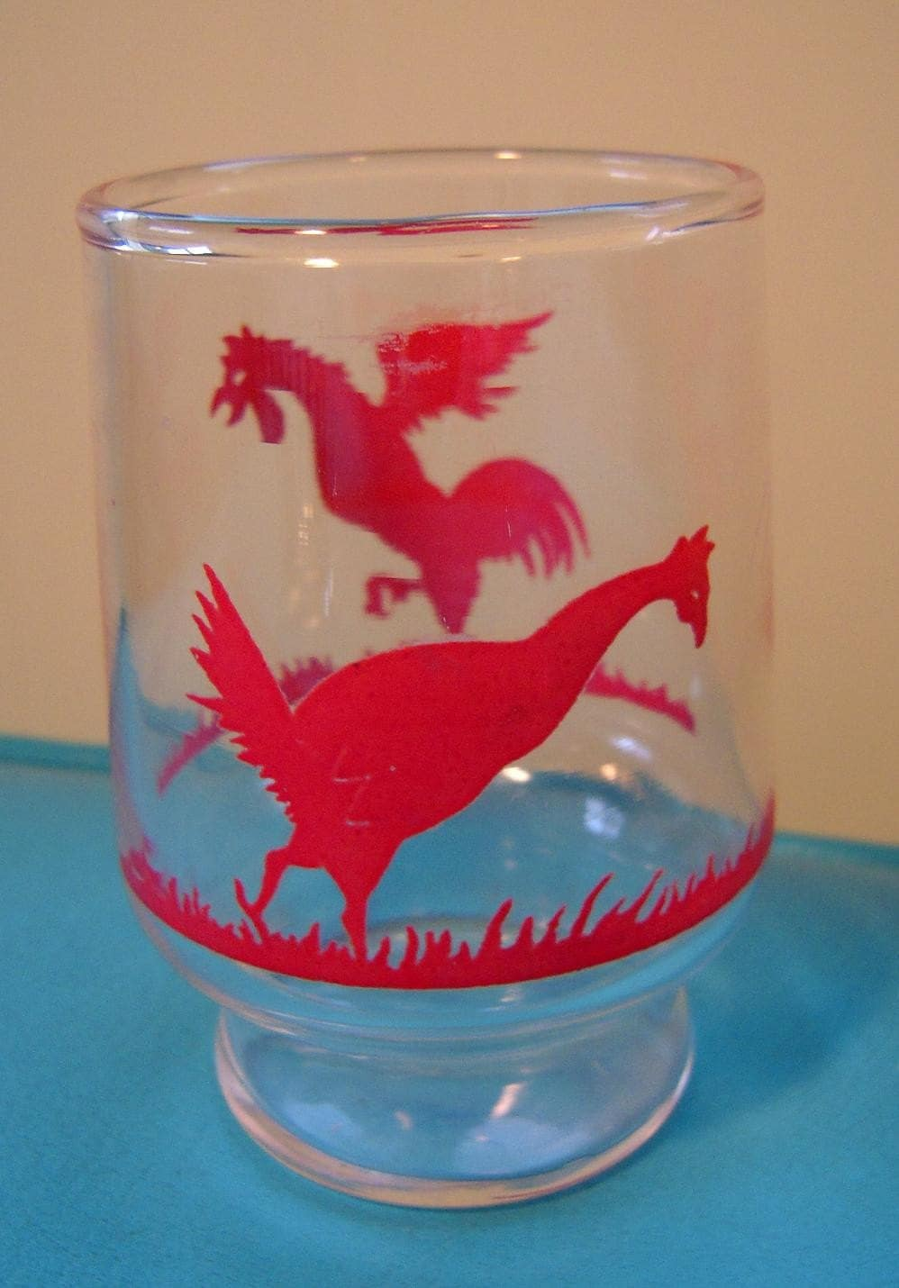 the roosters on this vintage glass mean business, I mean check out that strut! a perfect juice glass to get your day started!