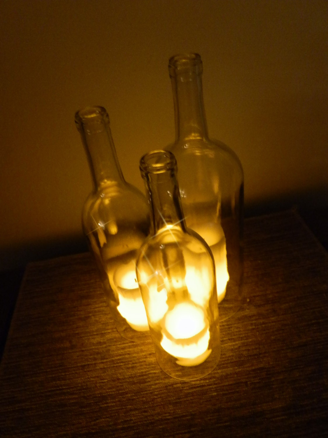 Triple wine bottle candle holder centerpiece by bomolutra for Wine glass lamp centerpiece