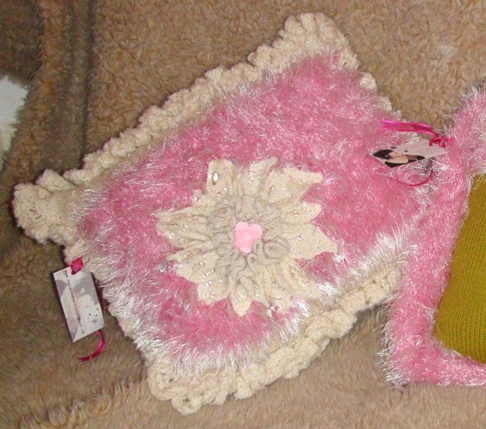 Pink and cream lusicous knitted cushion with HUGE flower and embellishments and frill