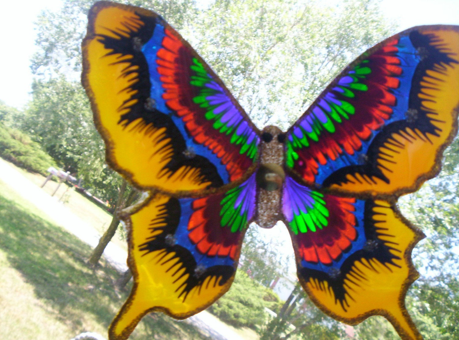 Yellow recycled plastic butterfly window decor