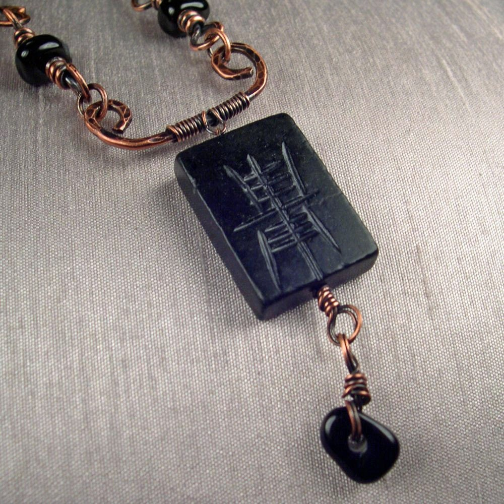 Dark Mystery  necklace with a carved black by KatalinaJewelry from etsy.com