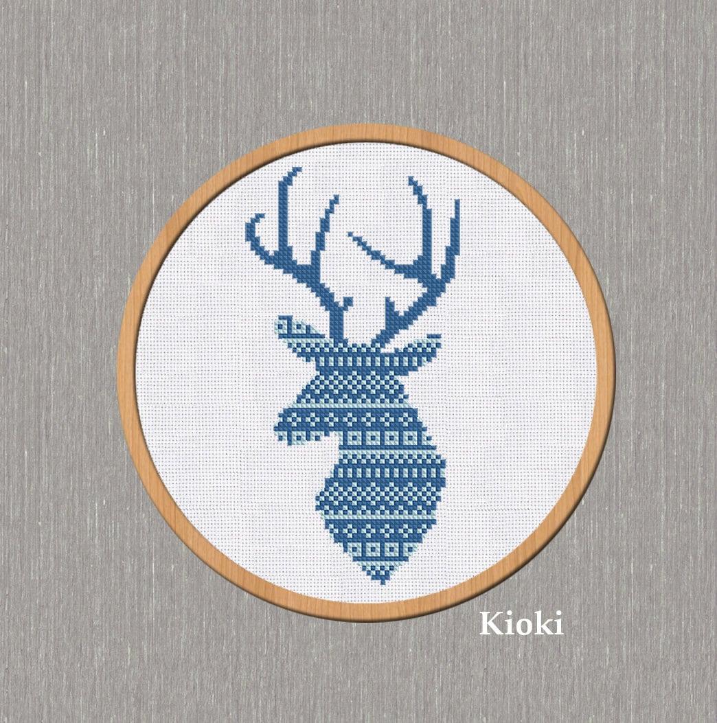 Вышивка крестом северный олень