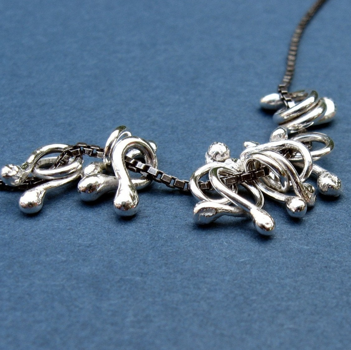 HooBeDoos on an oxidized box chain..  sterling silver