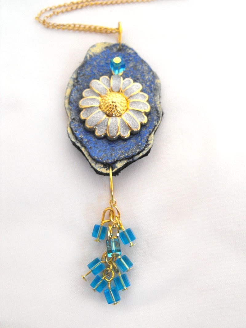 Flower pendant. Shades of blue and yellow leather flower pendant with chamomile charm. Comes with a chain.
