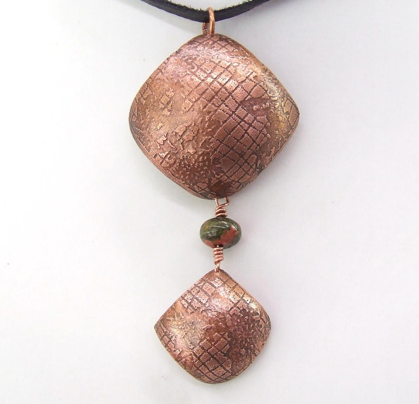 etched copper pendant