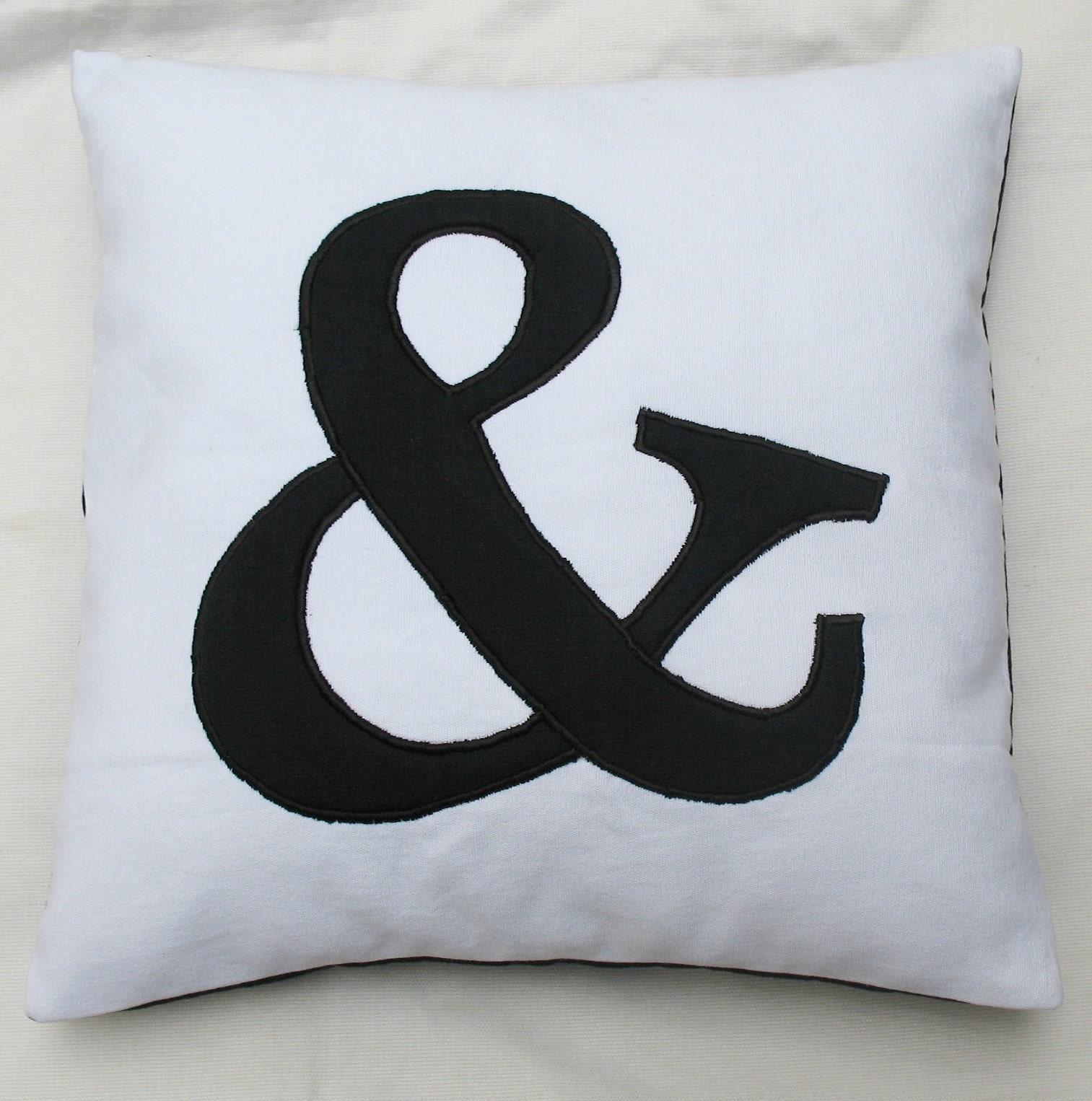 ampersand, applique, and, cushion