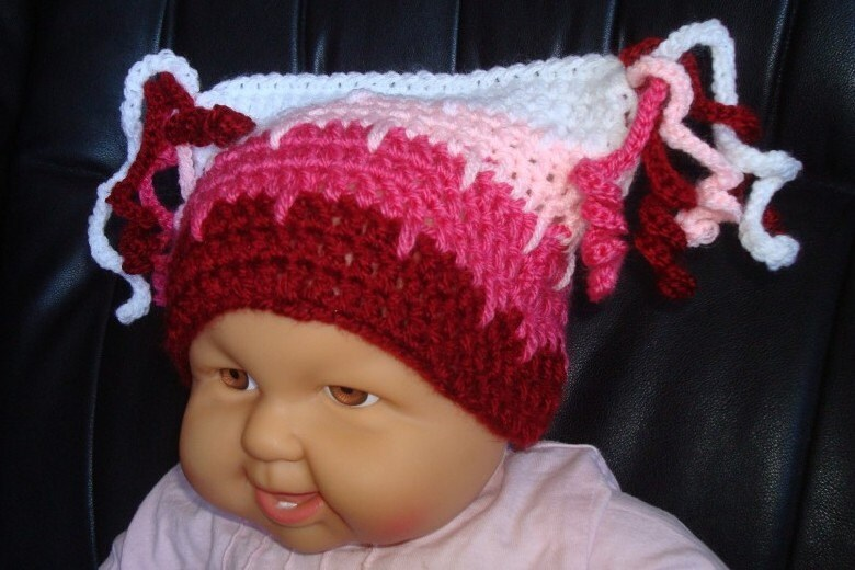 Berry mix striped hat with double peculiar curly tassels.0 - 12 month.Perfect for a gift or for a photo prop. Item 004.