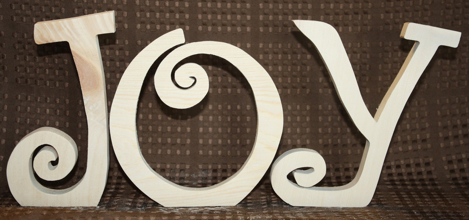 "Joy unfinished wood word to decorate you home for the season  6"" tall"