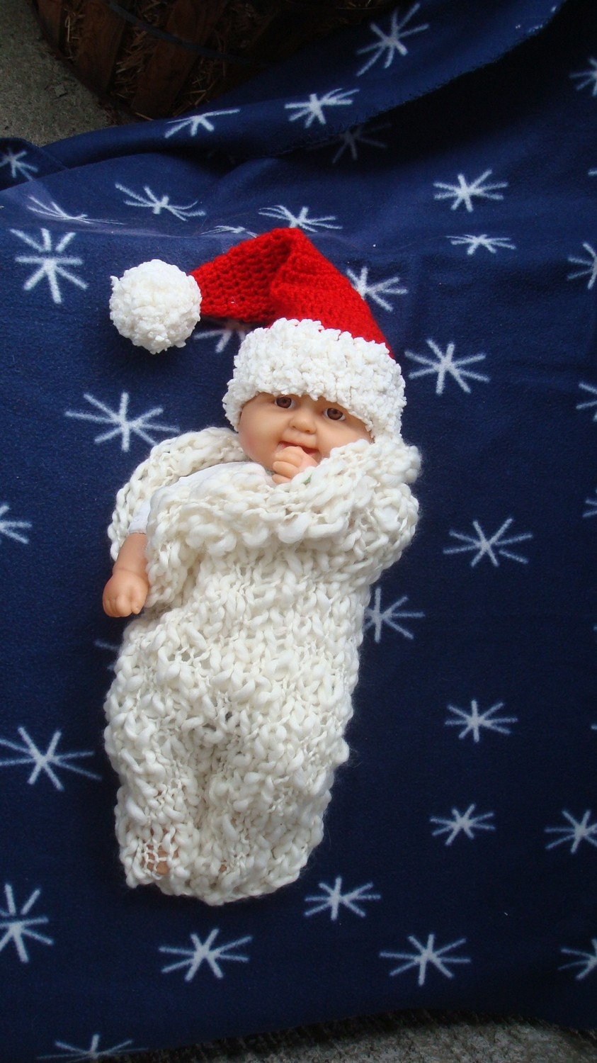 Santa-hat in traditional Christmas red colour with white fluffy edge and same pom pom. Sizes 0-12month. Item 062 My first Christmas