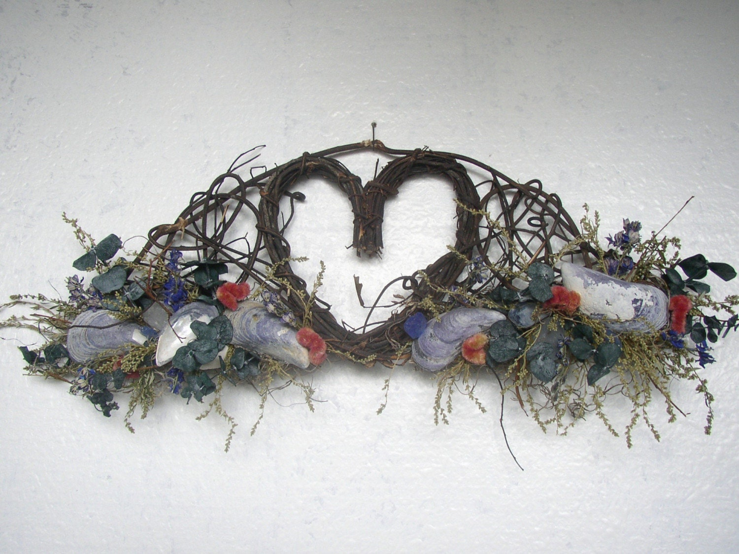 Twig Wall Piece with Heart Shaped Center decorated with Shells and Dried Flowers
