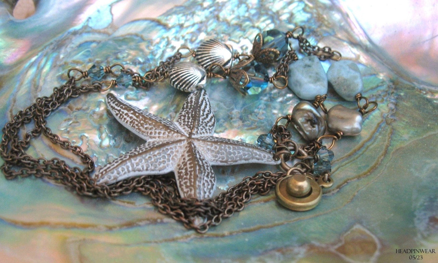 A Brass White Starfish combined with Pearls, Gemstones, Sterling Silver, and Brass