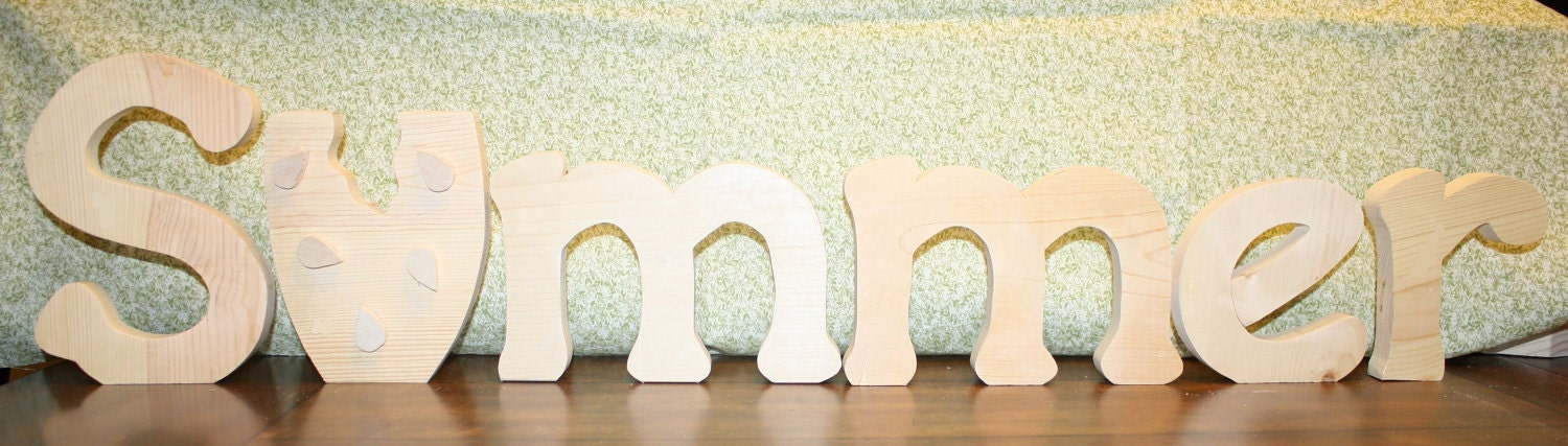 "UNFINISHED SUMMER wood letters with a watermellon for the ""U""."