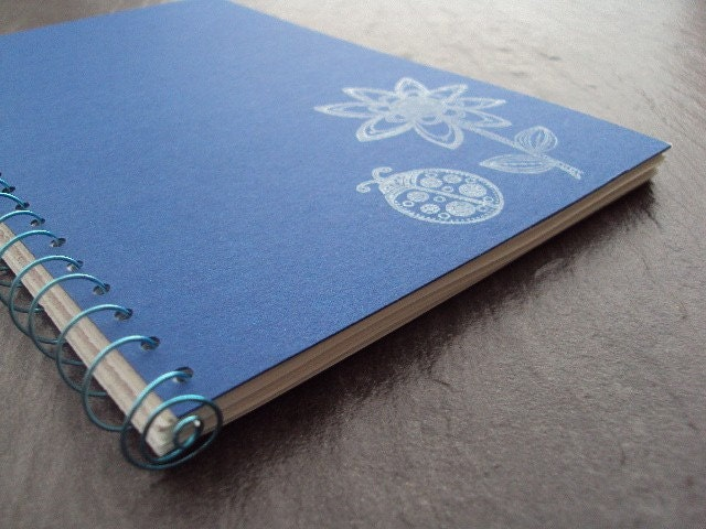 book journal, blue cover with white flower, writing journal