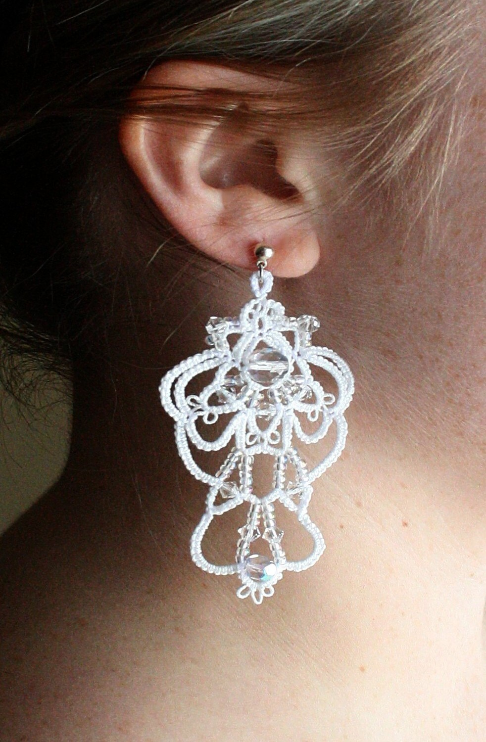 White crocheted earrings with crystals