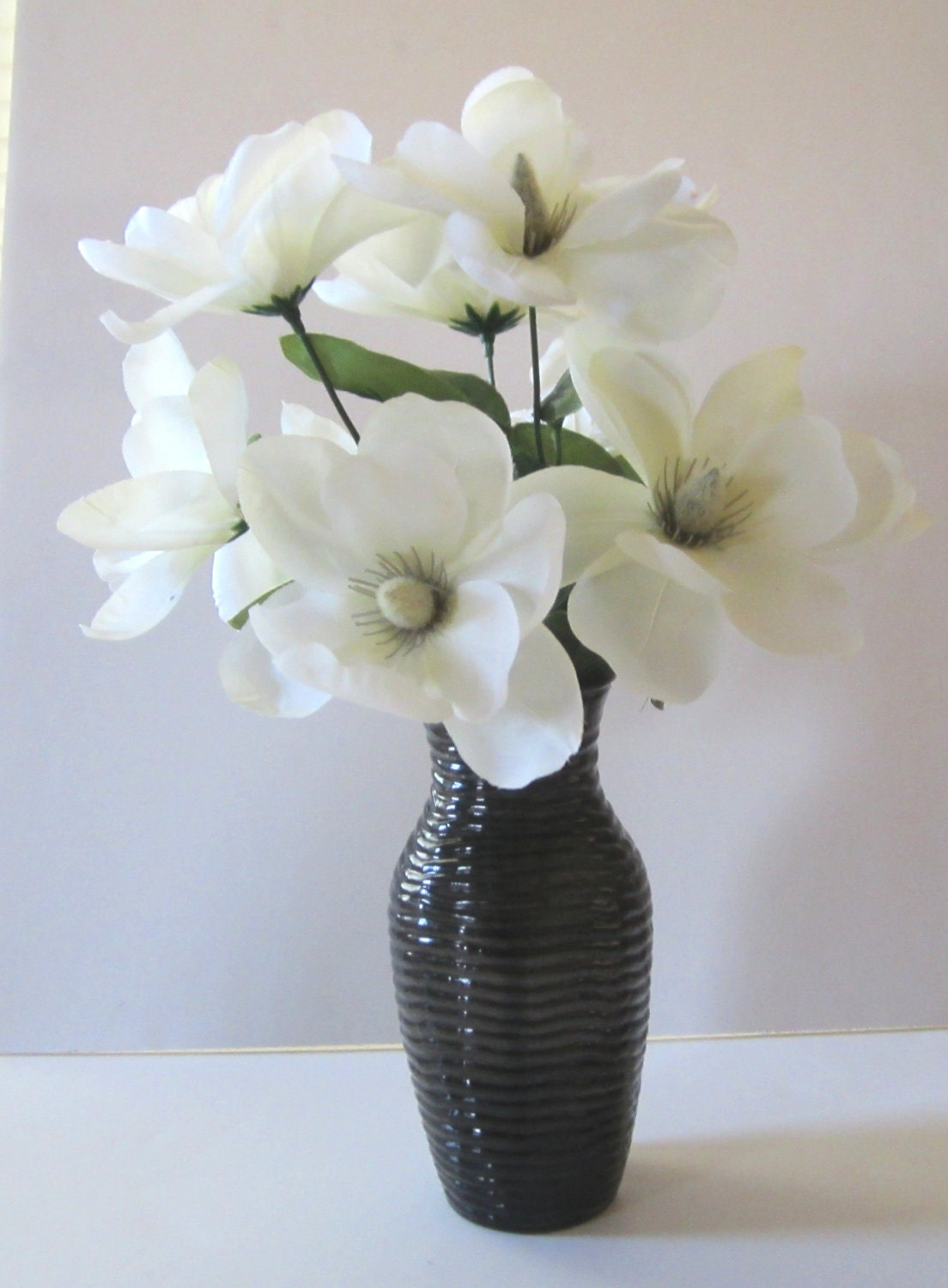 Silk Floral Arrangement In A Black Vase With By