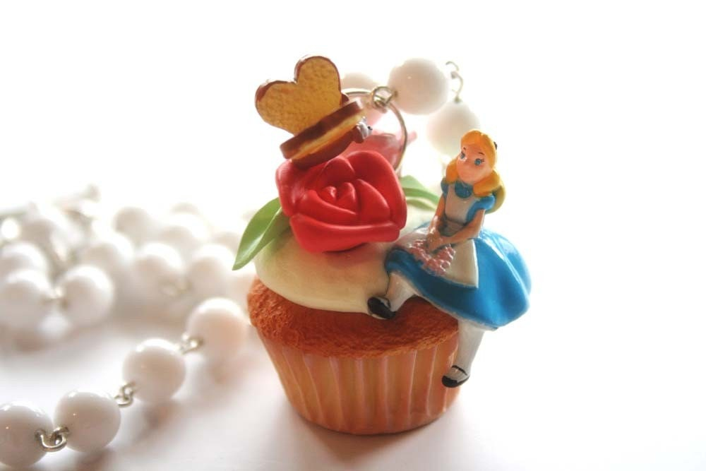 Alice is on a huge cupcake necklace