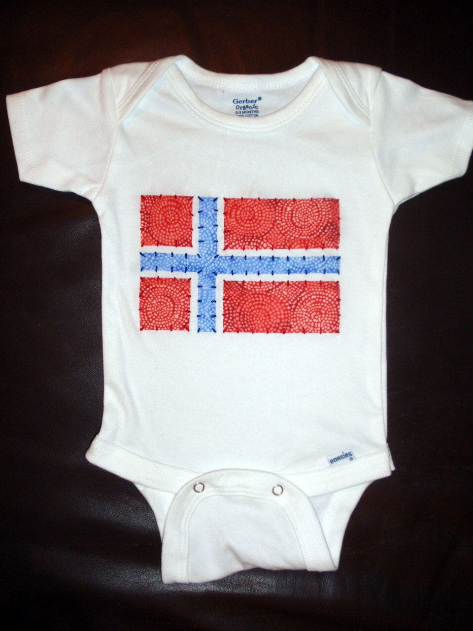 Custom Organic Onesie with Hand-Embroidered Flag Applique