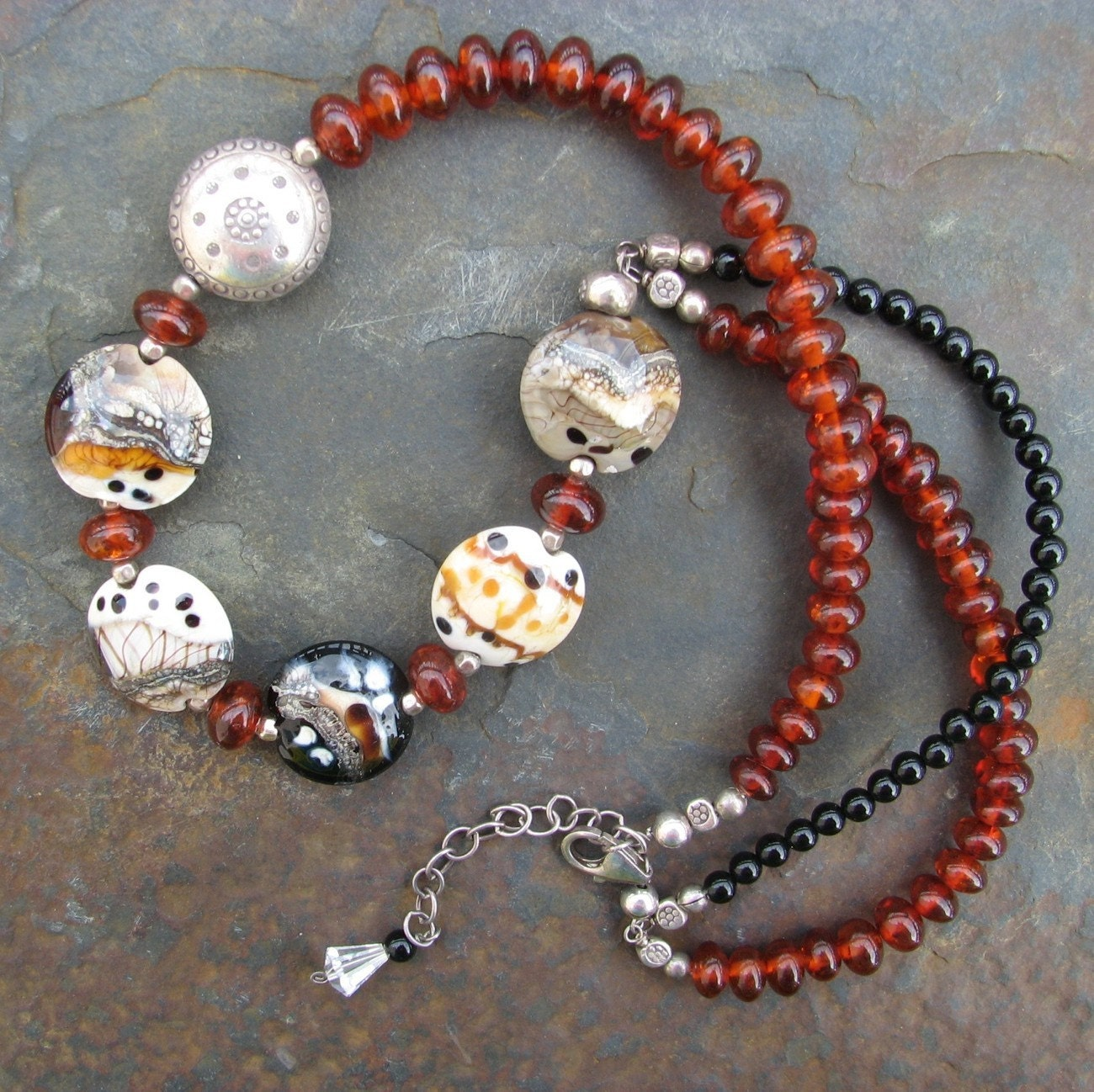 Outback artisan lampwork with Baltic amber and black onyx