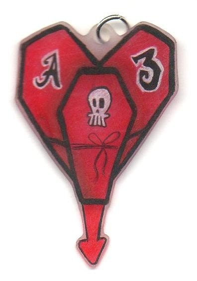 this is the alkaline trio logo drawn in an interesting way with coffins that