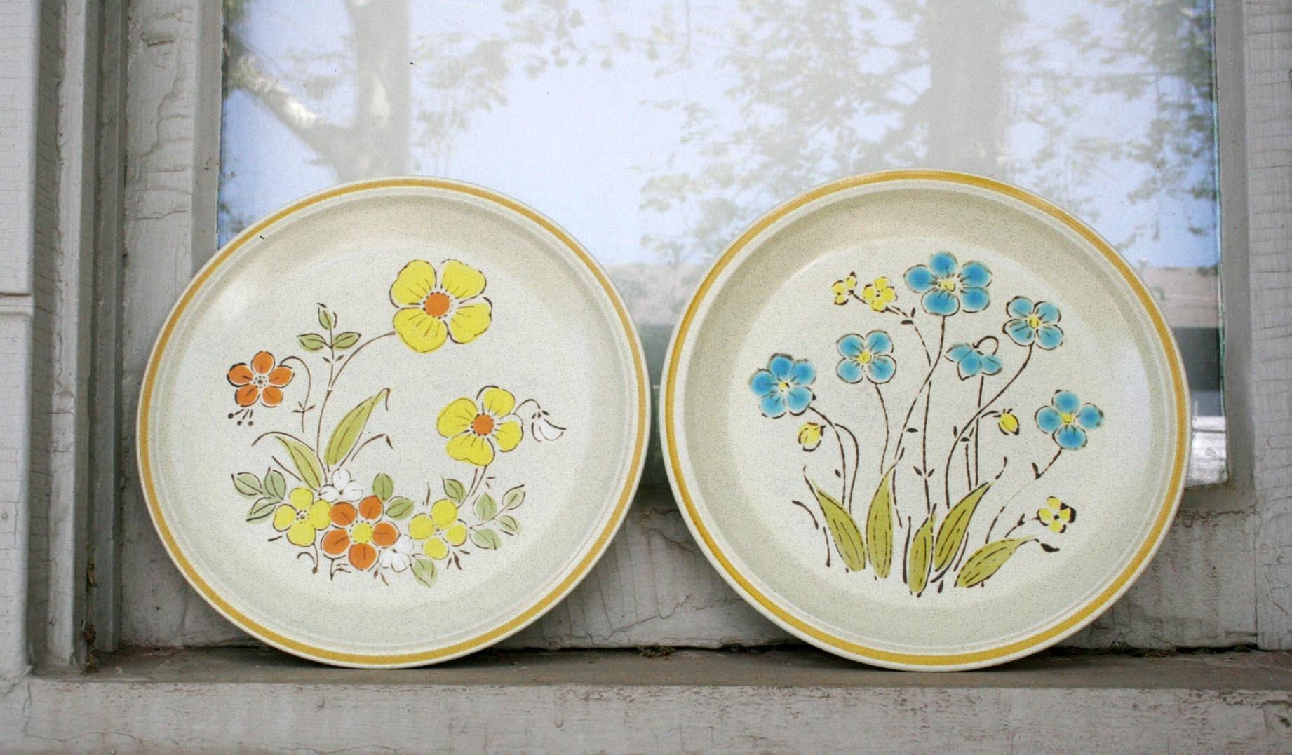 retro set of handpainted hearthside stoneware plates